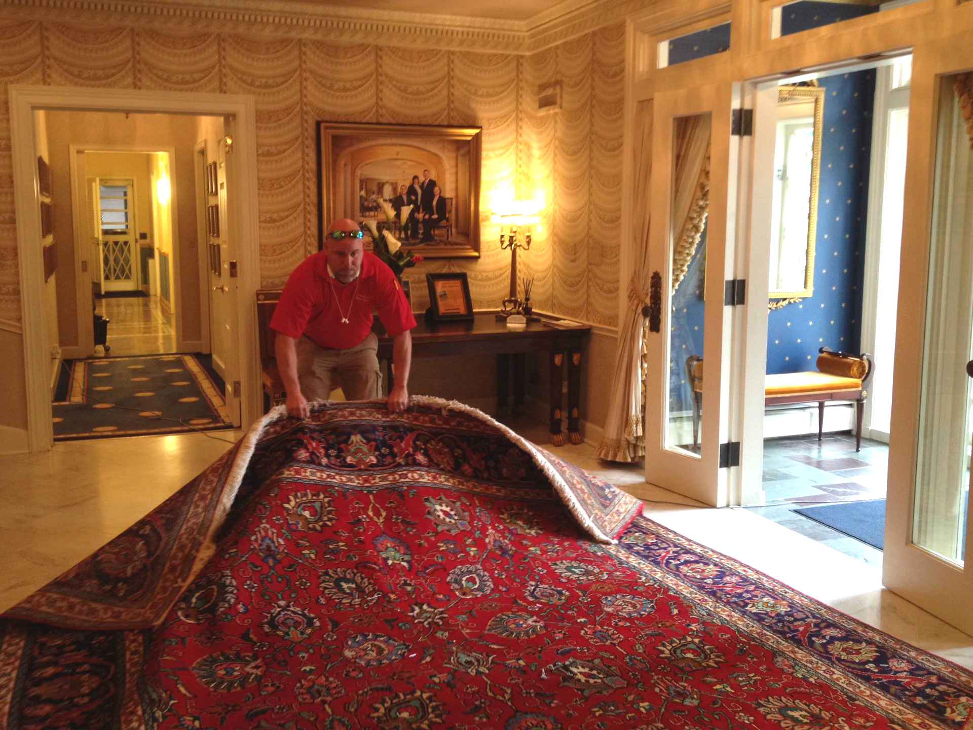 Cam Mayville returning a rug to the Governor's Mansion in Lincoln. Nebraska